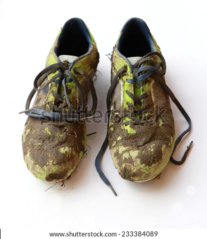 dirty cleats - stock photo