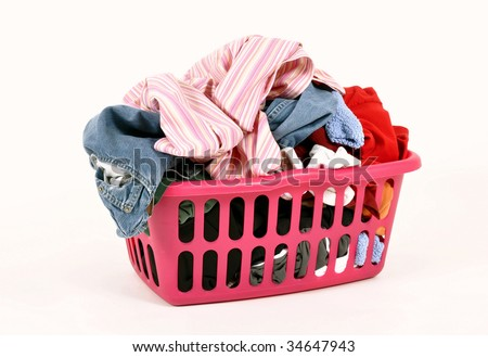 Dirty clothes in a laundry basket - stock photo