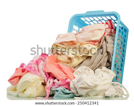 Dirty Clothes in basket on white background - stock photo
