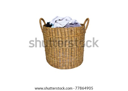 dirty clothes in the basket isolated - stock photo