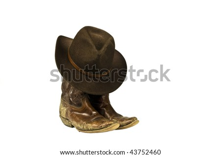 dirty cowboy boots and hat isolated - stock photo