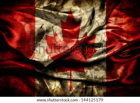 Dirty crumpled flag of Canada on silk background - stock photo