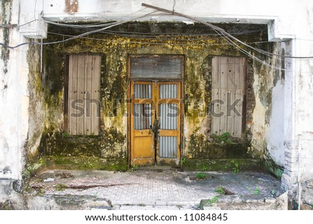 dirty decayed house front - stock photo