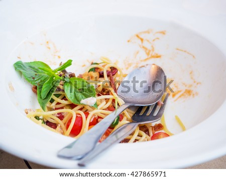 Dirty dish of spicy spaghetti after eatten - stock photo