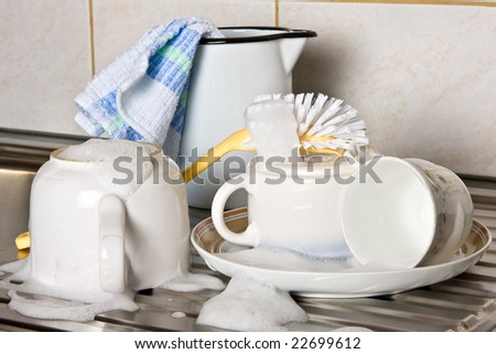 Dirty dishes almost done on a kitchen sink - stock photo