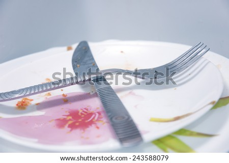 Dirty dishes in sink - stock photo