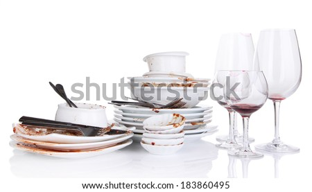 Dirty dishes isolated on white - stock photo