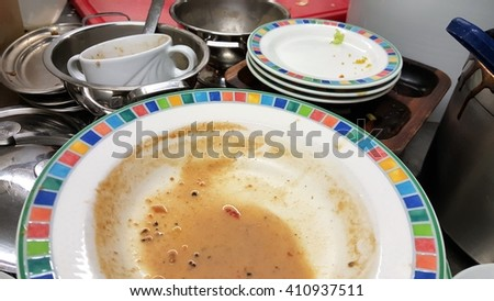 Dirty dishes on the sink. - stock photo