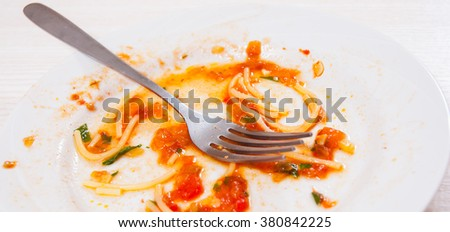 dirty dishes. sauce smeared on a plate. - stock photo