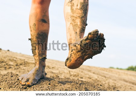 Dirty feet paced - stock photo