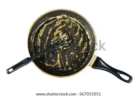 Dirty frying pan after cooking isolated on white background - stock photo