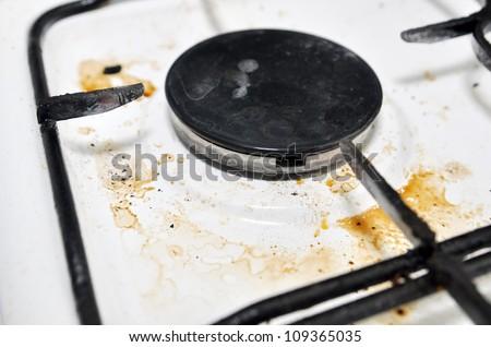 Dirty gas burner closeup - stock photo