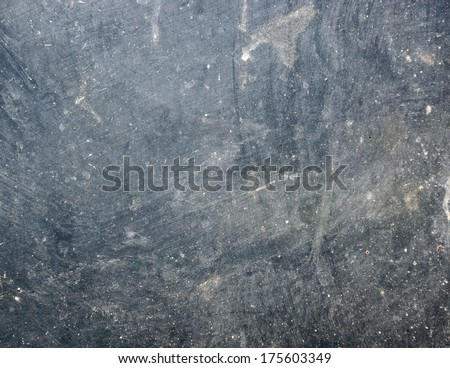 Dirty glass lit by the sun - stock photo