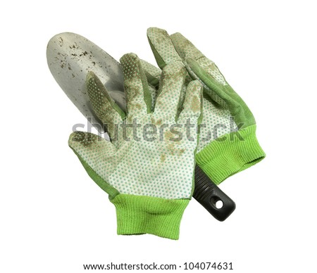 dirty gloves and shovel from garden work on a white background - stock photo