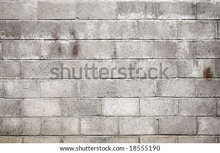 Dirty gray breeze blocks wall background.