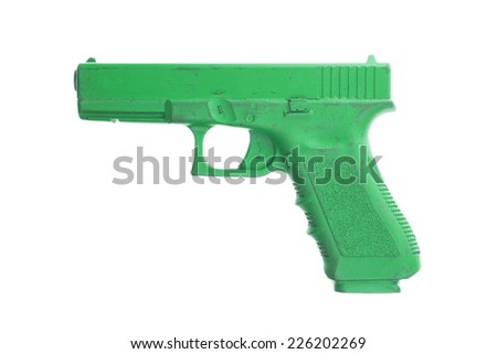 Dirty green training gun isolated on white, law enforcement - stock photo
