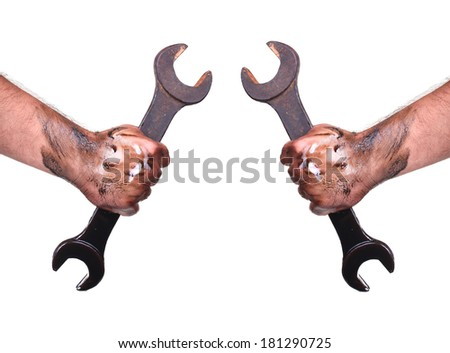 Dirty hands with wrench - stock photo