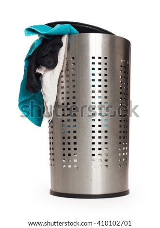 Dirty laundry in a metal basket, isolated on a white background - stock photo