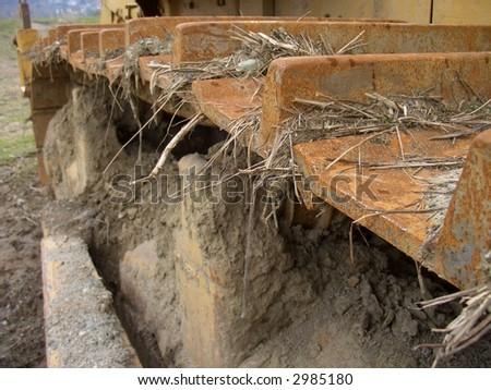 Dirty Machine Tread - stock photo