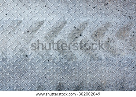 Dirty metal pattern and tyre tracks - stock photo