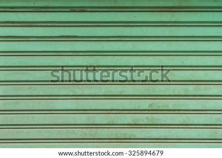 dirty metal shutters texture can be used as background