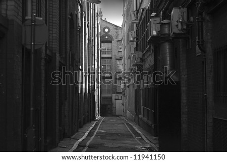 Dirty narrow inner city back alley - stock photo
