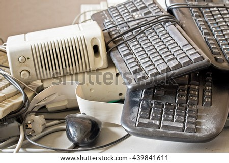 dirty old keyboard, mouse, speakers for electronic recycling - stock photo