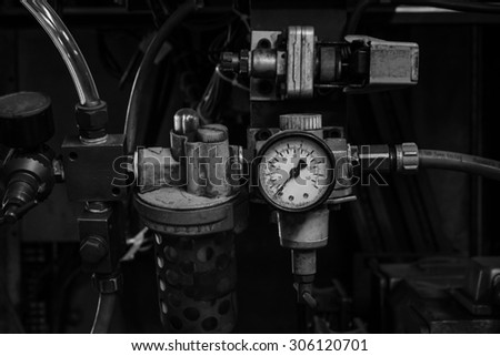 Dirty old manometer,Black and White - stock photo