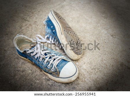 Dirty old shoes on the floor - stock photo