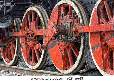 Dirty old steam locomotive wheels - stock photo