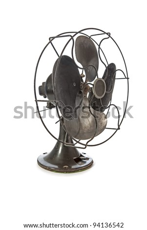 Dirty old vintage metal fan isolated on white - stock photo