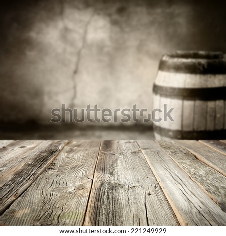 dirty old wine barrel and wooden table  - stock photo