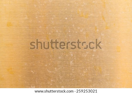 Dirty on gold stainless steel surface - stock photo