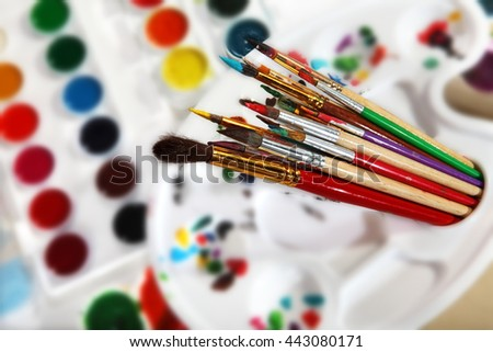 Dirty paintbrushes. Selective focus