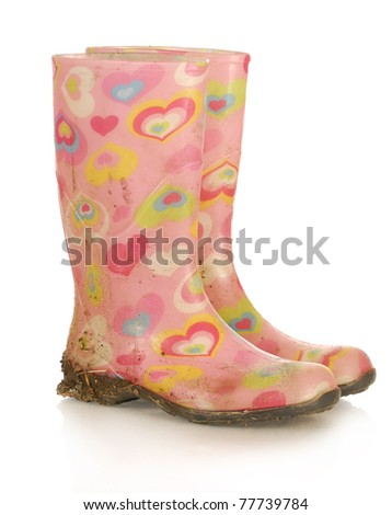 dirty pink rubber boots on white background - stock photo
