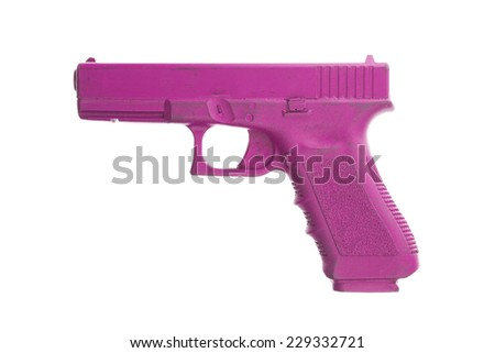 Dirty pink training gun isolated on white, law enforcement - stock photo