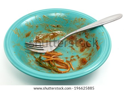 Dirty plate after eating spaghetti with tomato sauce - stock photo