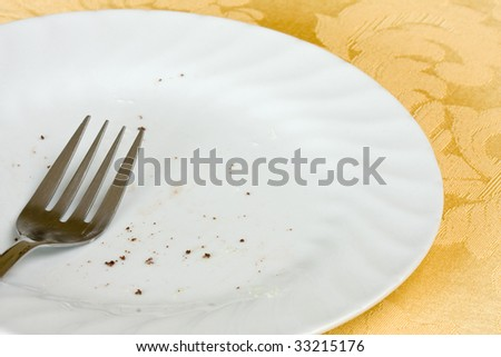 dirty plate with pie crumbs and fork