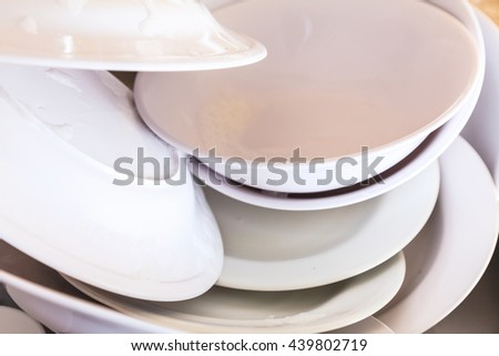 Dirty Plates and dishes in the sink