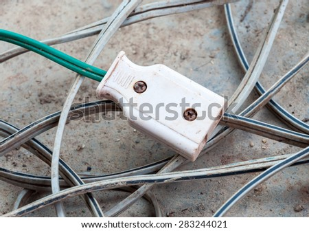 Dirty plug socket on the complex electric wire. - stock photo