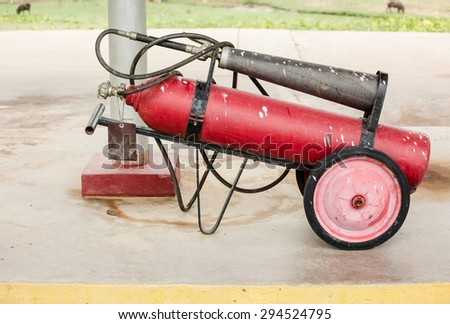 Dirty red fire protection tank - stock photo