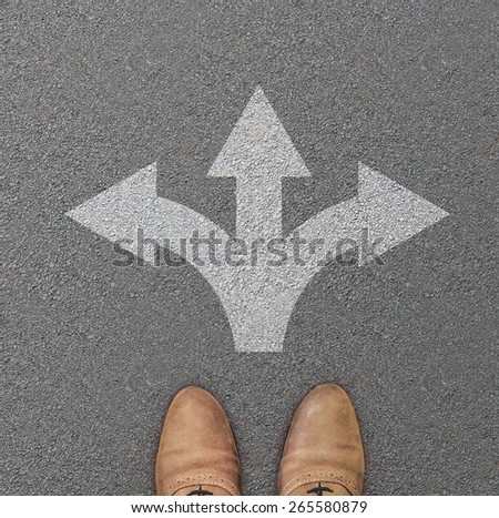 Dirty red shoes from above with yellow arrow. - stock photo
