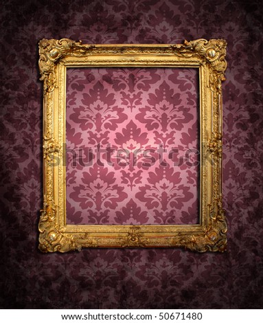 dirty red wallpaper and an empty frame - stock photo