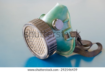 Dirty Respiratory Protection on blue background - stock photo