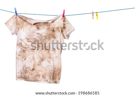 dirty shirt hanging to dry - stock photo