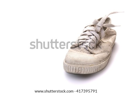 dirty shoe on white background, Old white sneakers, one of old casual sport shoe in white thick fabric - stock photo