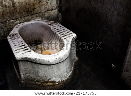 Dirty squat type toilet - stock photo