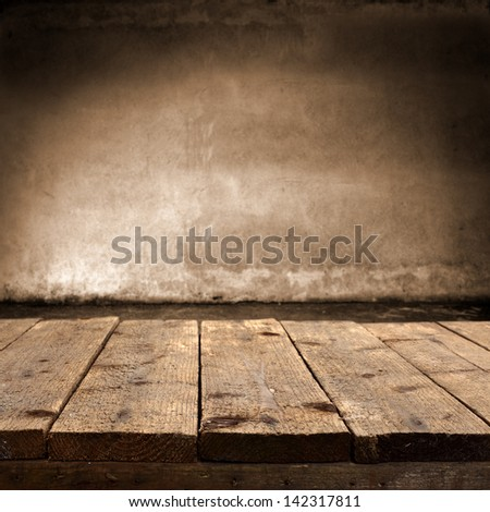 dirty table of wood and dark wall - stock photo