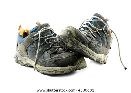 Dirty trekking shoes - stock photo