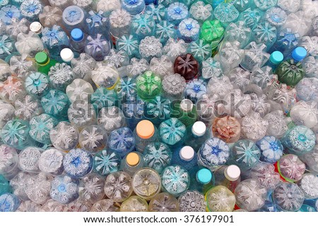 Dirty used colored plastic bottle pile ready to be recycled - stock photo